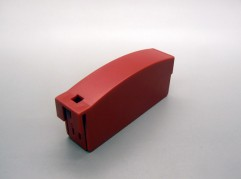Red plastic component