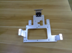 Punched and bended aluminium metal sheet component