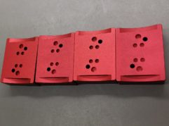 CNC machining of aluminium casing with red anodisation